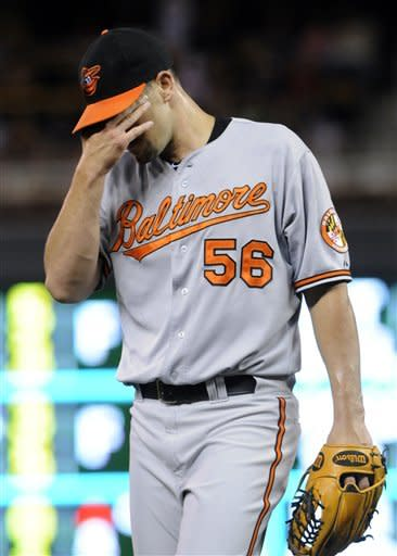 Baltimore Orioles pitcher Darren O'Day leaves the game after giving up the third run of the sixth inning to the Minnesota Twins, Monday, July 16, 2012, in Minneapolis. The Twins won 19-7. (AP Photo/Jim Mone)