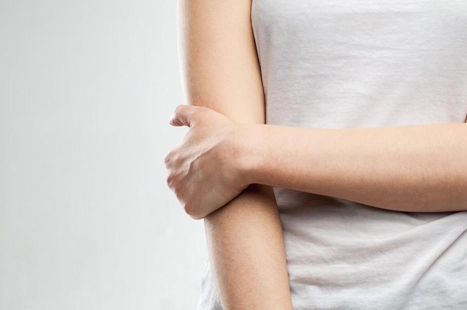 Young girl with pain in the elbow