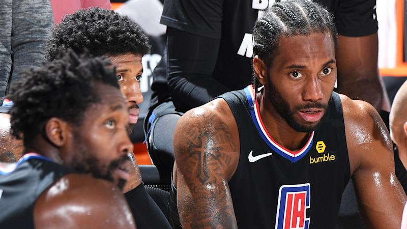 Kawhi Leonard is pictured looking on during a timeout.