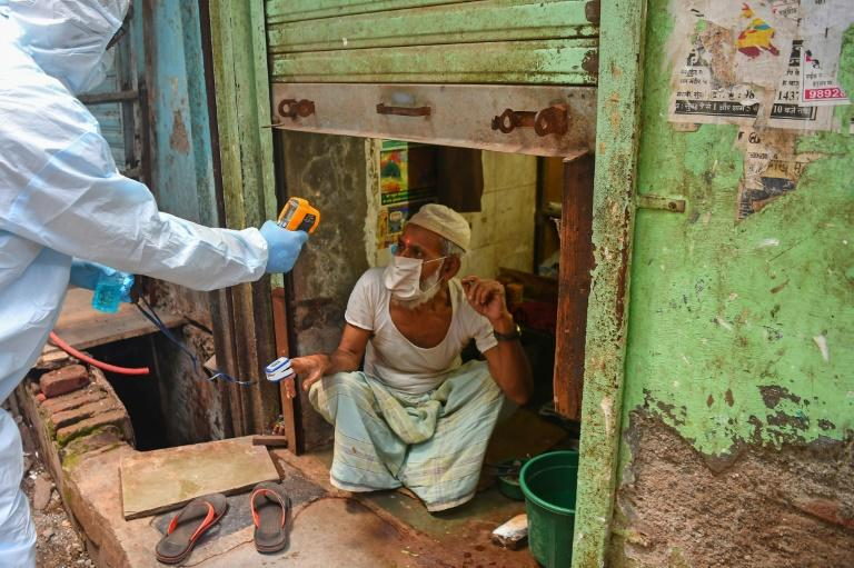 By late June, more than half the slum's population had been screened for symptoms and around 12,000 tested for coronavirus (AFP Photo/INDRANIL MUKHERJEE)