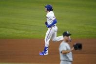 Texas Rangers' Jonah Heim, rear, rounds the bases after hitting a two-run home run off of Seattle Mariners starting pitcher Tyler Anderson during the fifth inning of a baseball game in Arlington, Texas, Saturday, July 31, 2021. (AP Photo/Tony Gutierrez)