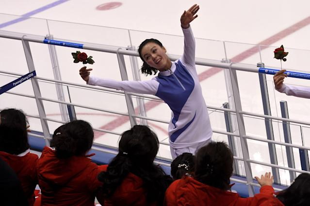 <p>North Korea's cheerleaders cheer during the women's preliminary round ice hockey match between Switzerland and the Unified Korean team during the Pyeongchang 2018 Winter Olympic Games at the Kwandong Hockey Centre in Gangneung on February 10, 2018. </p>