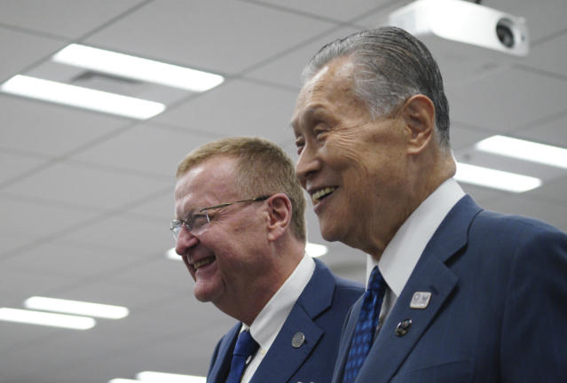 John Coates, left, chairman of the IOC Coordination Commission for the 2020 Tokyo Olympics and Paralympics and Tokyo Olympic organizing committee President Yoshiro Mori walk together away from the venue of the IOC and Tokyo 2020 joint press conference Wednesday, Sept. 12, 2018. (AP Photo/Eugene Hoshiko)