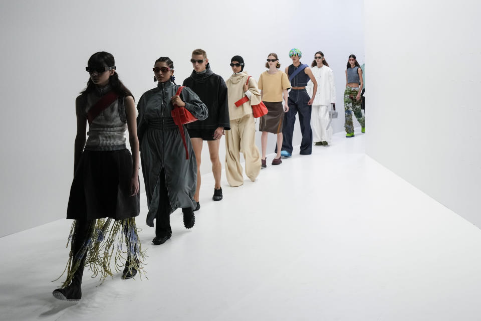 Models wear creations for the Sunnei Spring Summer 2022 collection during Milan Fashion Week, in Milan, Italy, Friday, Sept. 24, 2021. (AP Photo/Antonio Calanni)
