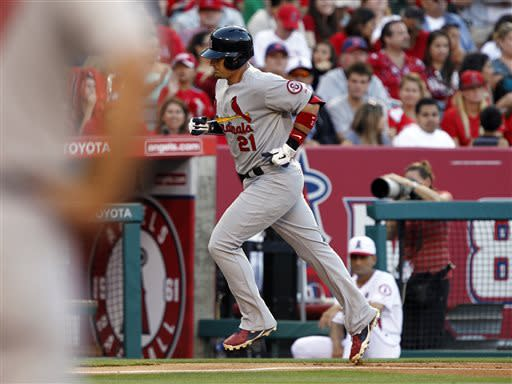 St. Louis Cardinals designated hitter Allen Craig (21) rounds third after hitting a three-run home run against the Los Angeles Angels in the fourth inning during a baseball game on Thursday, July 4, 2013, in Anaheim, Calif. (AP Photo/Alex Gallardo)