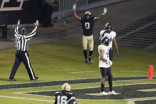 Purdue wide receiver Milton Wright (0) celebrates a touchdown against Northwestern during the fourth quarter of an NCAA college football game in West Lafayette, Ind., Saturday, Nov. 14, 2020. Northwestern defeated Purdue 27-20. (AP Photo/Michael Conroy)