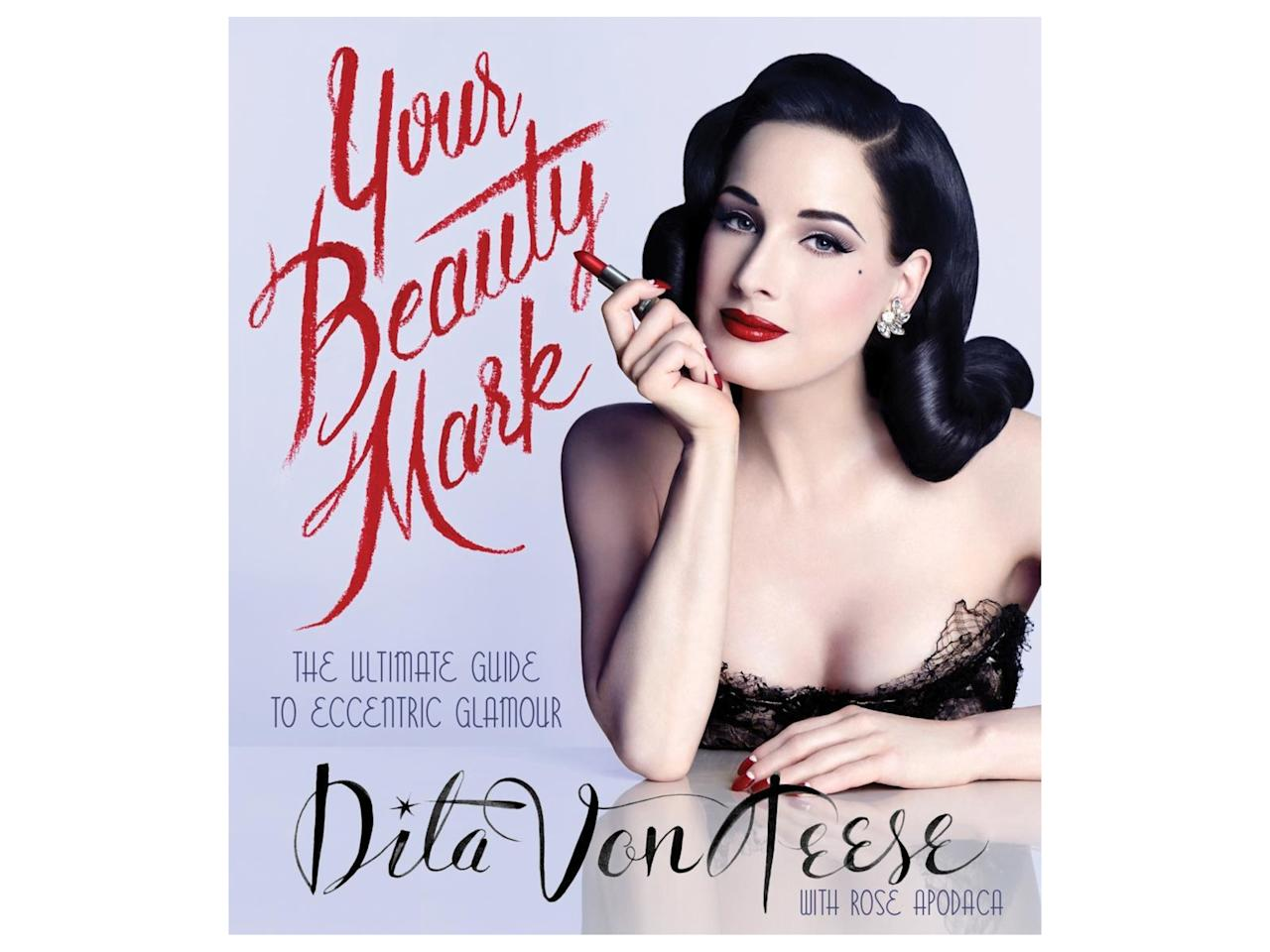 """<p><em>Your Beauty Mark: The Ultimate Guide to Eccentric Glamour book</em></p><p>Buy it <a rel=""""nofollow"""" href=""""https://www.amazon.com/Your-Beauty-Mark-Ultimate-Eccentric/dp/0060722711?ie=UTF8&camp=1789&creative=9325&linkCode=as2&creativeASIN=0060722711&tag=instycom00-20&ascsubtag=61fc1e711d4d7b44e89ebf55d62bd9c9"""">here</a> for $27.</p>"""