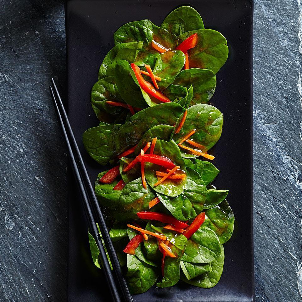"""<p>This spinach salad tossed with spunky ginger dressing was inspired by the iceberg salads served at Japanese steakhouses across the U.S. Add shrimp for lunch or a light supper. <a href=""""https://www.eatingwell.com/recipe/252932/spinach-salad-with-japanese-ginger-dressing/"""" rel=""""nofollow noopener"""" target=""""_blank"""" data-ylk=""""slk:View recipe"""" class=""""link rapid-noclick-resp""""> View recipe </a></p>"""