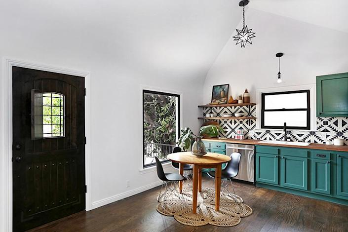 <p>The kitchen is now a completely updated, unified space with unique details and dark hardwood floors.<i> (Photo: Charmaine David for Kenihan Development)</i><br></p>