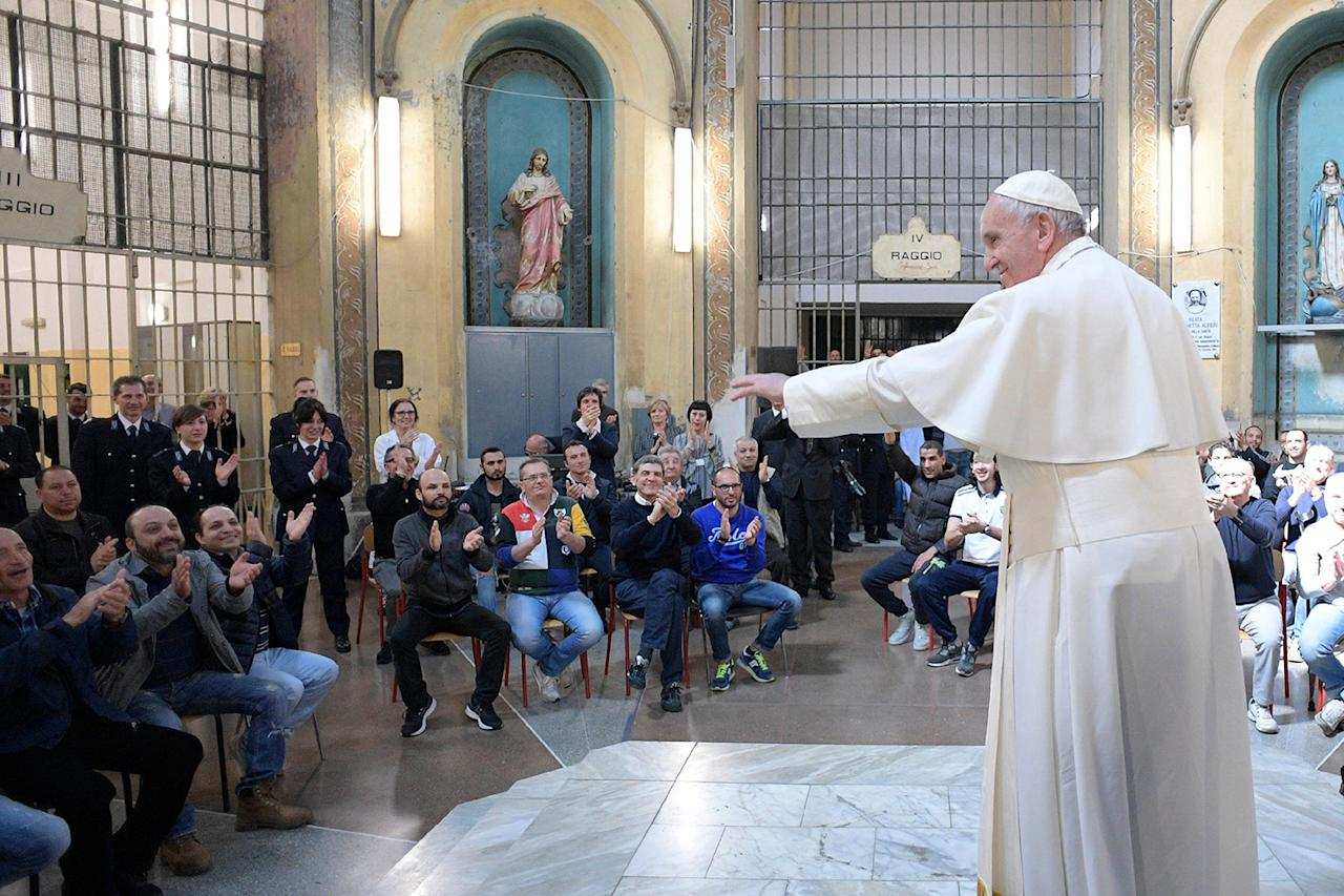 <p>Pope Francis meets with prisoners at the San Vittore penitentiary in Milan, as part of his one-day pastoral visit to Monza and Milan, Italy's second-largest city, March 25, 2017. Pope Francis began his one-day visit Saturday to the world's largest diocese which included a stop at the city's main prison as well as a blessing at the Gothic-era Duomo cathedral. (Photo: L'Osservatore Romano/AP) </p>
