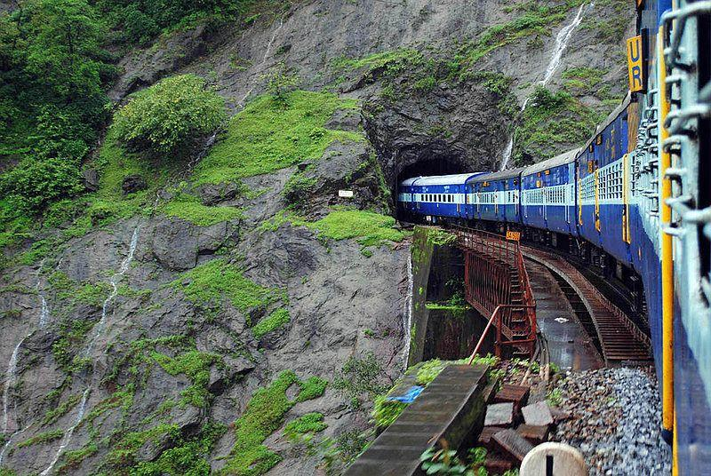 The vasco Express escapes from a tunnel and negotiates a small viaduct as it continues down the Ghats.