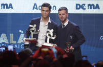 Juventus' Cristiano Ronaldo, left, stands with the trophy for best Italian Serie A player, as he poses with his teammate Miralem Pjanic, winner of the best Italian Serie A midfielder, during the Gran Gala' soccer awards ceremony, in Milan, Italy, Monday, Dec. 2, 2019. (AP Photo/Antonio Calanni)