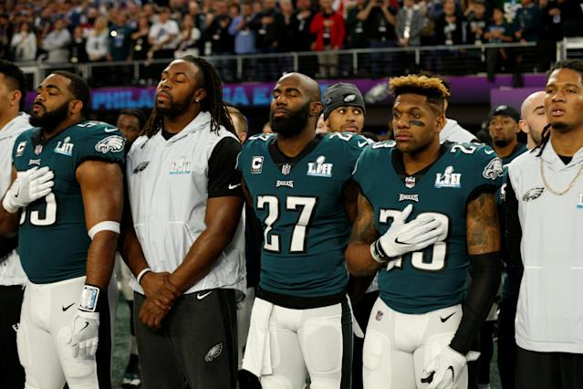 NFL Football - Philadelphia Eagles v New England Patriots - Super Bowl LII - U.S. Bank Stadium, Minneapolis, Minnesota, U.S. - February 4, 2018 Philadelphia EaglesÕ Rodney McLeod and Malcolm Jenkins during the national anthems before the game REUTERS/Kevin Lamarque