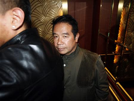 Birmingham City owner Carson Yeung stands in the lift after leaving in the middle of a general meeting at a hotel in Hong Kong February 5, 2014. REUTERS/Bobby Yip