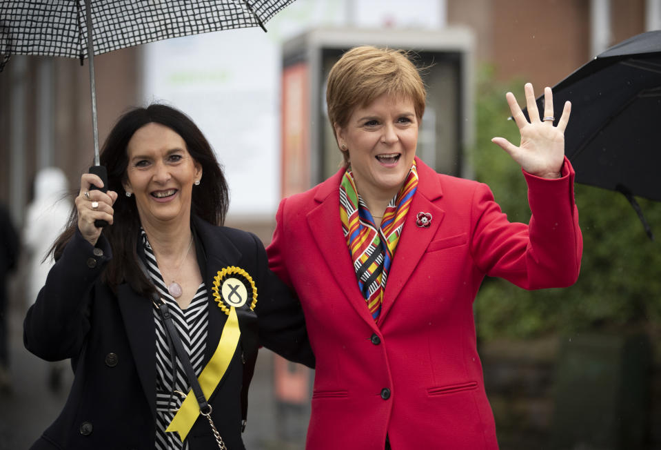 SNP leader Nicola Sturgeon (right) with Margaret Ferrier, SNP candidate for Rutherglen, during her visit to Burnside Pharmacy in Rutherglen, Glasgow, meeting voters and activists while on the General Election campaign. (Photo by Jane Barlow/PA Images via Getty Images)