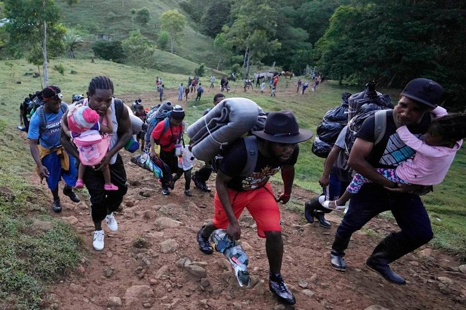 Migrants continue on their trek north, near Acandi, Colombia, Wednesday, 15 September 2021. The migrants, mostly Haitians, are on their way to crossing the Darien Gap from Colombia into Panama dreaming of reaching the US (AP)
