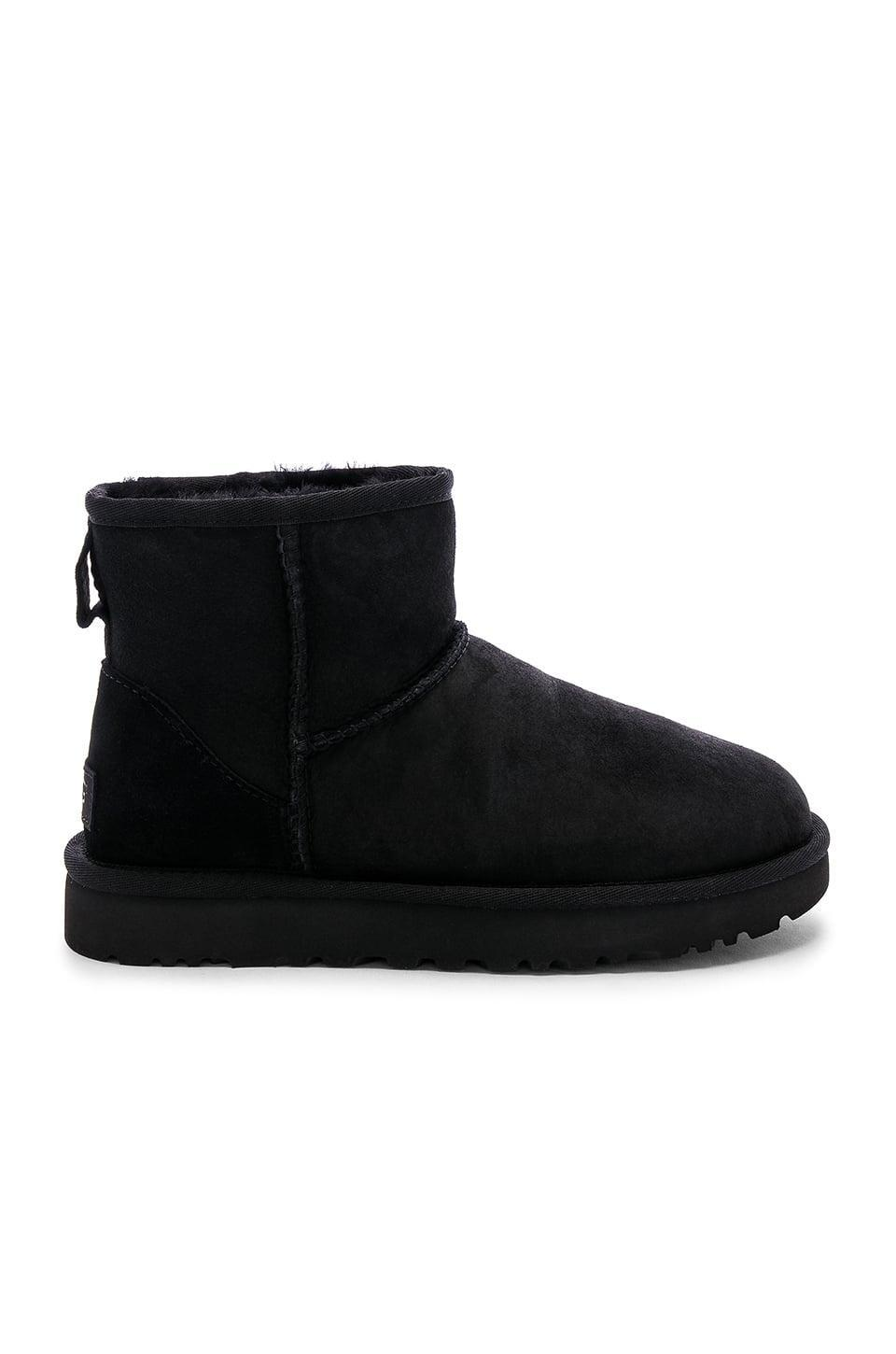 <p>Stay cozy in these iconic <span>UGG Classic Mini II Booties</span> ($150).</p>