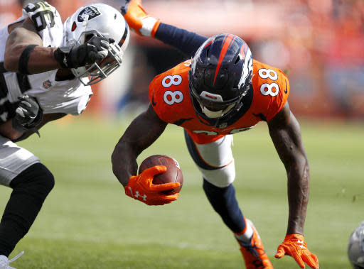 Denver Broncos wide receiver Demaryius Thomas (88) is hit by Oakland Raiders linebacker Derrick Johnson (56) during the second half of an NFL football game, Sunday, Sept. 16, 2018, in Denver. (AP Photo/Jack Dempsey)