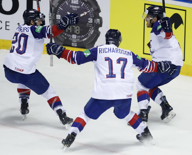 Great Britain's Ben Davies, right, celebrates with teammates Mark Richardson, center, and Jonathan Phillips, left, after scoring his sides winning goal during the Ice Hockey World Championships group A match between France and Great Britain at the Steel Arena in Kosice, Slovakia, Monday, May 20, 2019. (AP Photo/Petr David Josek)