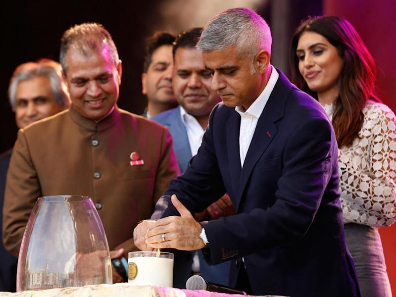 Mayor of London Sadiq Khan lights a ceremonial candle at the Diwali Festival at Trafalgar Square in London (AP)