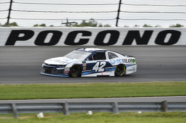 Kyle Larson drives through Turn 3 during a NASCAR Cup Series auto race, Sunday, June 3, 2018, in Long Pond, Pa. Martin Truex Jr. won the race. (AP Photo/Derik Hamilton)