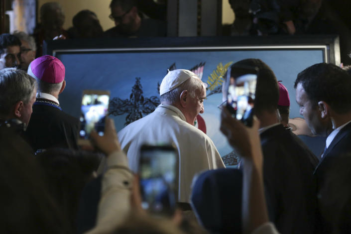 Pope Francis leaves after a meeting with Catholic priests and other Christian representatives in the cathedral of the capital, Rabat, Morocco, Sunday, March 31, 2019. Pope Francis is in Morocco for a two-day trip aimed at highlighting the North African nation's Christian-Muslim ties, while also showing solidarity with migrants at Europe's door and tending to a tiny Catholic flock. (AP Photo/Mosa'ab Elshamy)