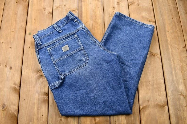 Lee Carpenter jeans folded on a table