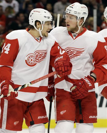 Detroit Red Wings' Damien Brunner, left, talks with teammate Justin Abdelkader during the first period of Game 5 of the NHL hockey Stanley Cup playoffs Western Conference semifinals against the Chicago Blackhawks in Chicago, Saturday, May 25, 2013. (AP Photo/Nam Y. Huh)