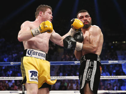 Canelo Alvarez (L) would be a great match for Gennady Golovkin, but television affiliations will likely prevent it from occurring. (AP Photo/Eric Jamison)