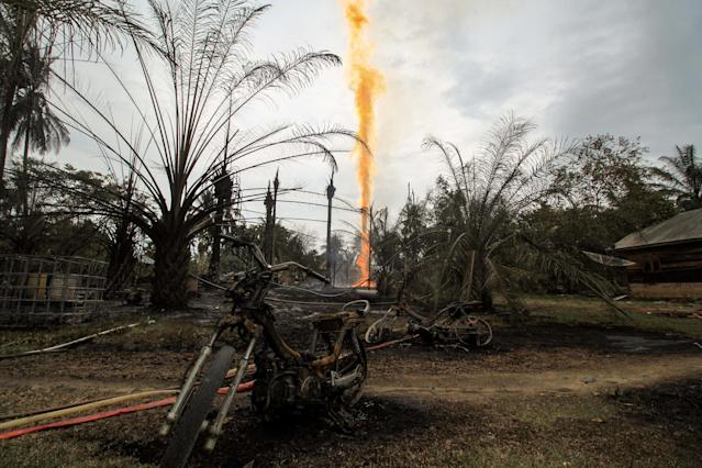 Damaged caused by fire from a burning illegal oil well is seen in Ranto Peureulak, Aceh Province, Indonesia April 25, 2018 in this photo taken by Antara Foto. Antara Foto/Rahmad/ via REUTERS ATTENTION EDITORS - THIS IMAGE WAS PROVIDED BY A THIRD PARTY. MANDATORY CREDIT. INDONESIA OUT. NO COMMERCIAL OR EDITORIAL SALES IN INDONESIA. TPX IMAGES OF THE DAY