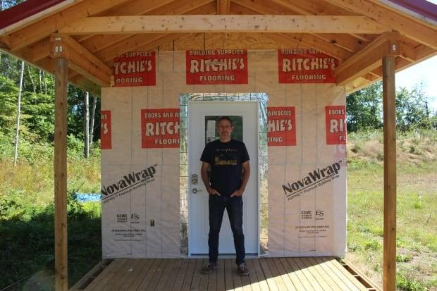 Marcel LeBrun has been working on this model tiny home in his backyard. If the project is approved, people could be moving into new homes as soon as this fall. (Vanessa Blanch/CBC - image credit)