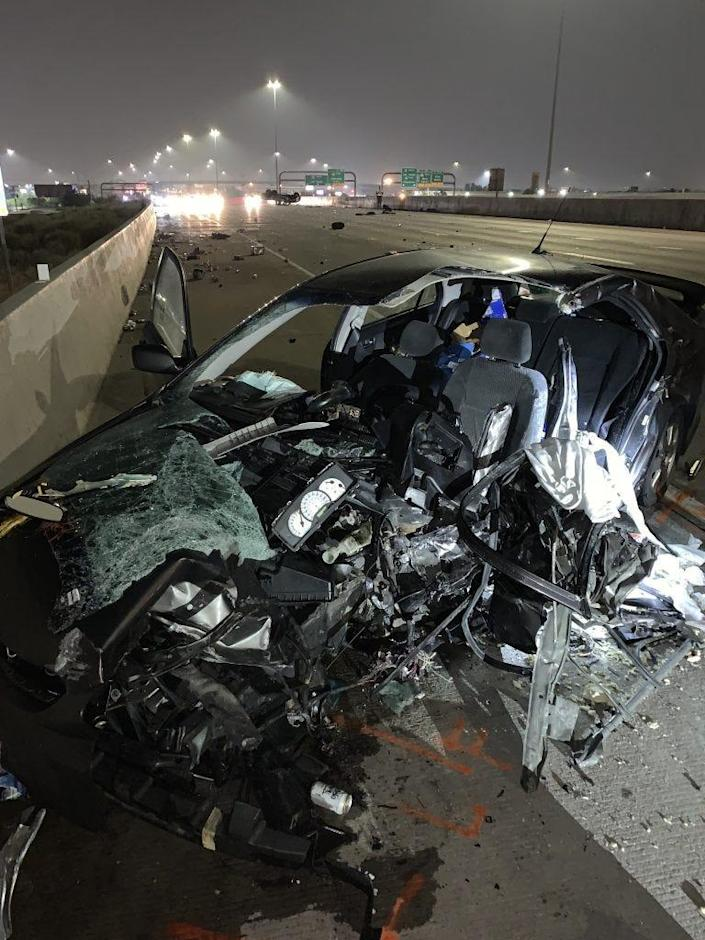 A Toyota Corolla was hit by a truck going the wrong way.
