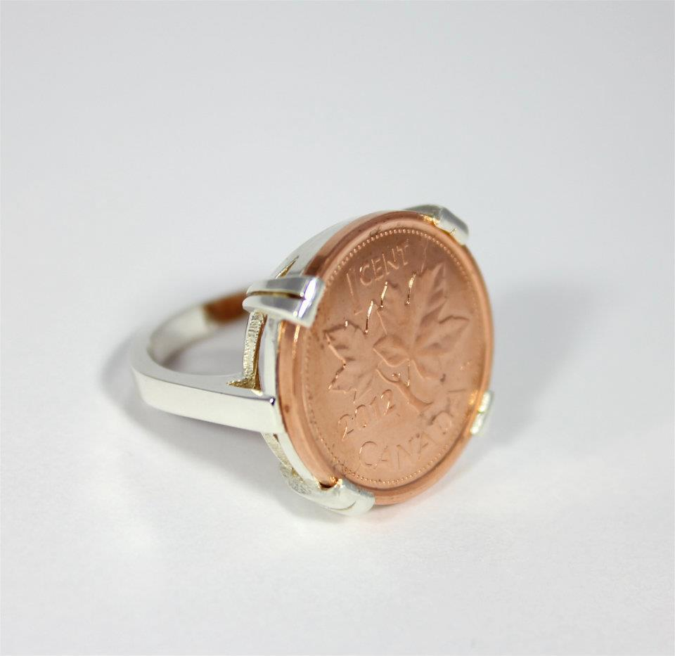 One of the rings displayed on Coin Coin designs & co.'s Facebook page. Renee Gruszecki designs jewelry using coins.