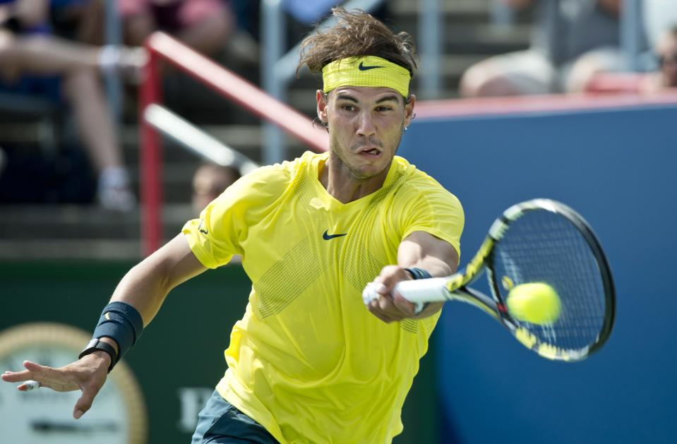 Rafael Nadal, from Spain, returns to Jesse Levine during the second round of play at the Rogers Cup men's tennis tournament on Wednesday Aug. 7, 2013, in Montreal. (AP Photo/The Canadian Press, Paul Chiasson)