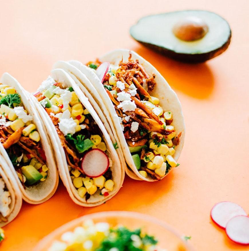 """<p>By shredding mushrooms and cooking them in a spicy paprika sauce, you can imitate spicy pulled pork tacos without any meat.</p> <p>Get the recipe <a href=""""https://www.liveeatlearn.com/corn-pulled-mushroom-vegetarian-tacos/?utm_medium=social&utm_source=pinterest&utm_campaign=tailwind_tribes&utm_content=tribes&utm_term=416139362_13995092_103457"""" rel=""""nofollow noopener"""" target=""""_blank"""" data-ylk=""""slk:here"""" class=""""link rapid-noclick-resp"""">here</a>.</p>"""