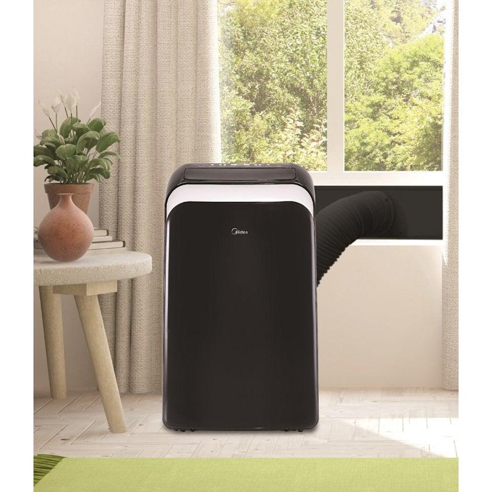 """<h2>Best Smart Portable Air Conditioner</h2><br><h3>Midea Smart Portable Air Conditioner</h3><br>This mobile AC unit is easily controlled by your smartphone, responds to voice commands via Amazon Alexa or Google Assistant, and can cool a room up to 450 square feet.<br><br><strong>The Hype</strong>: 4.5 out of 5 stars and 45 ratings on <a href=""""https://www.walmart.com/"""" rel=""""nofollow noopener"""" target=""""_blank"""" data-ylk=""""slk:Walmart"""" class=""""link rapid-noclick-resp"""">Walmart</a><br><br><strong>Easy-Breezy Buyers Say:</strong> """"I really like this portable air conditioner. It has a drain valve that lets the water out. It's smartphone compatible and has a portable remote. It can be controlled with your iOS or Android device, which makes a great feature! I love that it blows out lots of cold air and if I want to I can also use the heat function.""""<br><br><em>Shop</em> <strong><em><a href=""""https://www.walmart.com/tp/midea"""" rel=""""nofollow noopener"""" target=""""_blank"""" data-ylk=""""slk:Midea"""" class=""""link rapid-noclick-resp"""">Midea</a></em></strong><br><br><strong>Midea</strong> Smart Portable Air Conditioner, $, available at <a href=""""https://go.skimresources.com/?id=30283X879131&url=https%3A%2F%2Fwww.walmart.com%2Fip%2FMidea-10-000-BTU-13-500-BTU-ASHRAE-115V-Smart-Portable-Air-Conditioner-with-Heat-ComfortSense-Remote-Black%2F369999554"""" rel=""""nofollow noopener"""" target=""""_blank"""" data-ylk=""""slk:Walmart"""" class=""""link rapid-noclick-resp"""">Walmart</a>"""