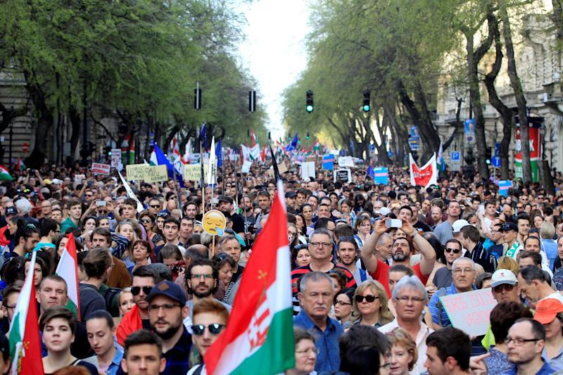People take to the streets in Budapest to oppose the government of Prime Minister Viktor Orbán on April 14. (Bernadett Szabo / Reuters)