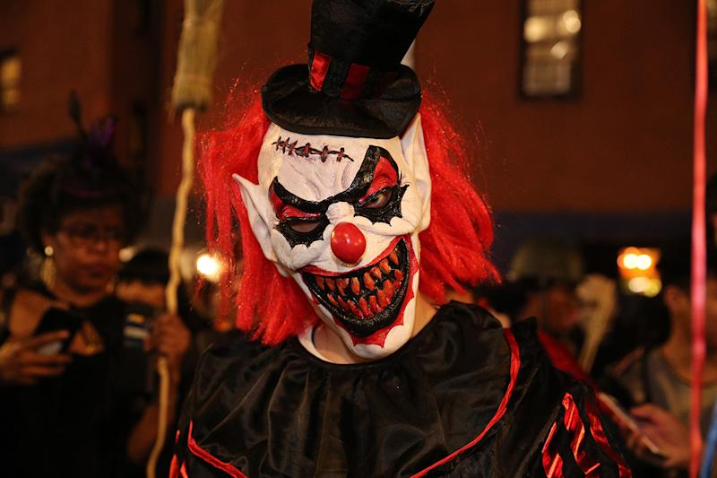 A scary clown mask is worn by a reveler during the Halloween Parade in New York City on Oct. 31, 2019. (Photo: Gordon Donovan/Yahoo News)