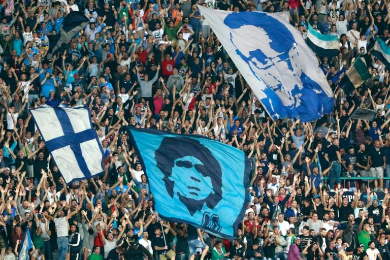 Napoli's fans cheer during the UEFA Champions League match against SL Benfica on September 28, 2016 at the San Paolo stadium in Naples