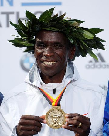 Athletics - Berlin Marathon - Berlin, Germany - September 16, 2018 Kenya's Eliud Kipchoge celebrates with a medal after winning the Berlin Marathon and breaking the World Record REUTERS/Fabrizio Bensch