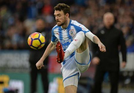 FILE PHOTO: Soccer Football - Premier League - Huddersfield Town vs Burnley - John SmithÕs Stadium, Huddersfield, Britain - December 30, 2017 Huddersfield Town's Scott Malone in action REUTERS/Peter Powell