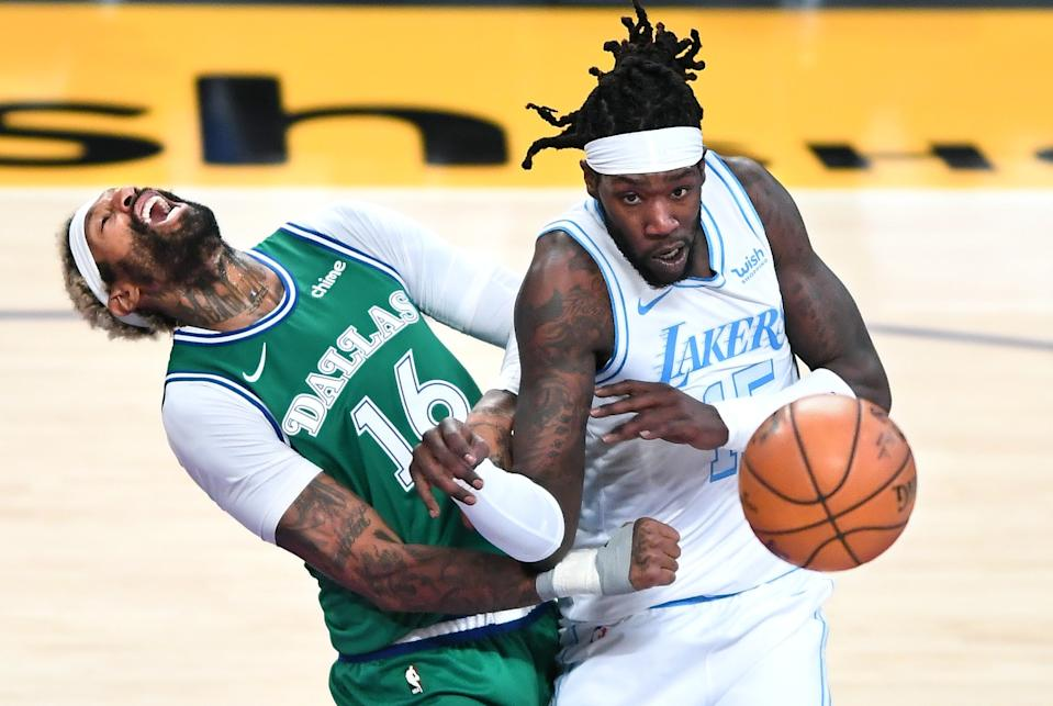 Lakers forward Montrezl Harrell collides with Mavericks forward James Johnson.