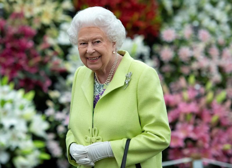 The Queen smiles as she clasps her hands together at the Chelsea Flower Show