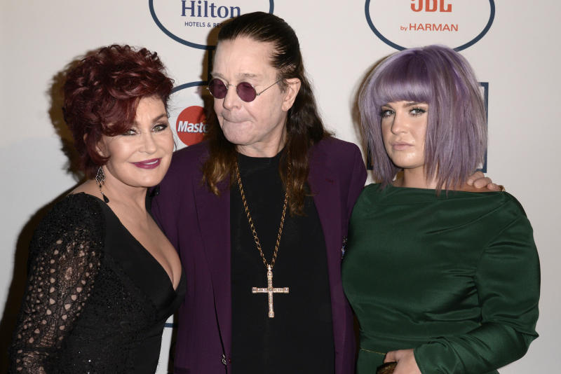 From left, Sharon Osbourne, Ozzy Osbourne and Kelly Osbourne arrive at the 56th annual GRAMMY awards - salute to industry icons with Clive Davis, on Saturday, Jan. 25, 2014, in Beverly Hills, Calif. (Photo by Dan Steinberg/Invision/AP)