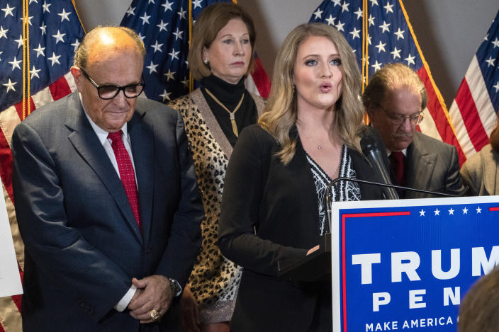 Members of President Donald Trump's legal team, including former Mayor of New York Rudy Giuliani, left, Sidney Powell, and Jenna Ellis, speaking, attend a news conference at the Republican National Committee headquarters on Nov. 19, 2020, in Washington. (Jacquelyn Martin/AP)