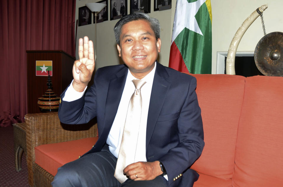 Kyaw Moe Tun, Myanmar's ambassador to the United Nations, shows a three-finger salute shared by opponents of the country's military coup during an interview in New York on June 28, 2021. The current envoy, Ambassador Kyaw Moe Tun, switched his allegiance soon after February's takeover to the opposition's underground National Unity Government, which styles itself as the legitimate alternative to the ruling generals. For at least a couple of months, he appears likely to keep his seat — or at least deny it to an appointee of the military government. (Kyodo News via AP)