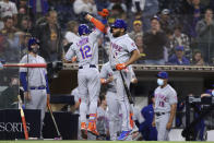 New York Mets' Francisco Lindor (12) celebrates with Dominic Smith, right, after hitting a solo home run off San Diego Padres starting pitcher Joe Musgrove during the fifth inning of a baseball game Saturday, June 5, 2021, in San Diego. (AP Photo/Derrick Tuskan)
