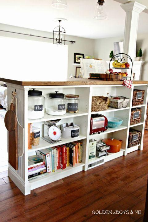 """<p>The bookshelf hack is kind of like the open shelving version of an island: The back is totally exposed and reveals organized compartments for baking supplies, books, and even snacks.</p><p>See more at <a href=""""http://www.goldenboysandme.com/2013/07/part-2-diy-billy-bookshelves-turned.html"""" rel=""""nofollow noopener"""" target=""""_blank"""" data-ylk=""""slk:Golden Boys & Me"""" class=""""link rapid-noclick-resp"""">Golden Boys & Me</a>.</p><p><a class=""""link rapid-noclick-resp"""" href=""""https://www.amazon.com/John-Boos-WALKCT-BL1225-O-Blended-Thickness/dp/B002MZRQOO/?tag=syn-yahoo-20&ascsubtag=%5Bartid%7C2089.g.29514474%5Bsrc%7Cyahoo-us"""" rel=""""nofollow noopener"""" target=""""_blank"""" data-ylk=""""slk:BUY NOW"""">BUY NOW</a> <strong><em>Wood Countertop, $99, amazon.com</em></strong></p>"""