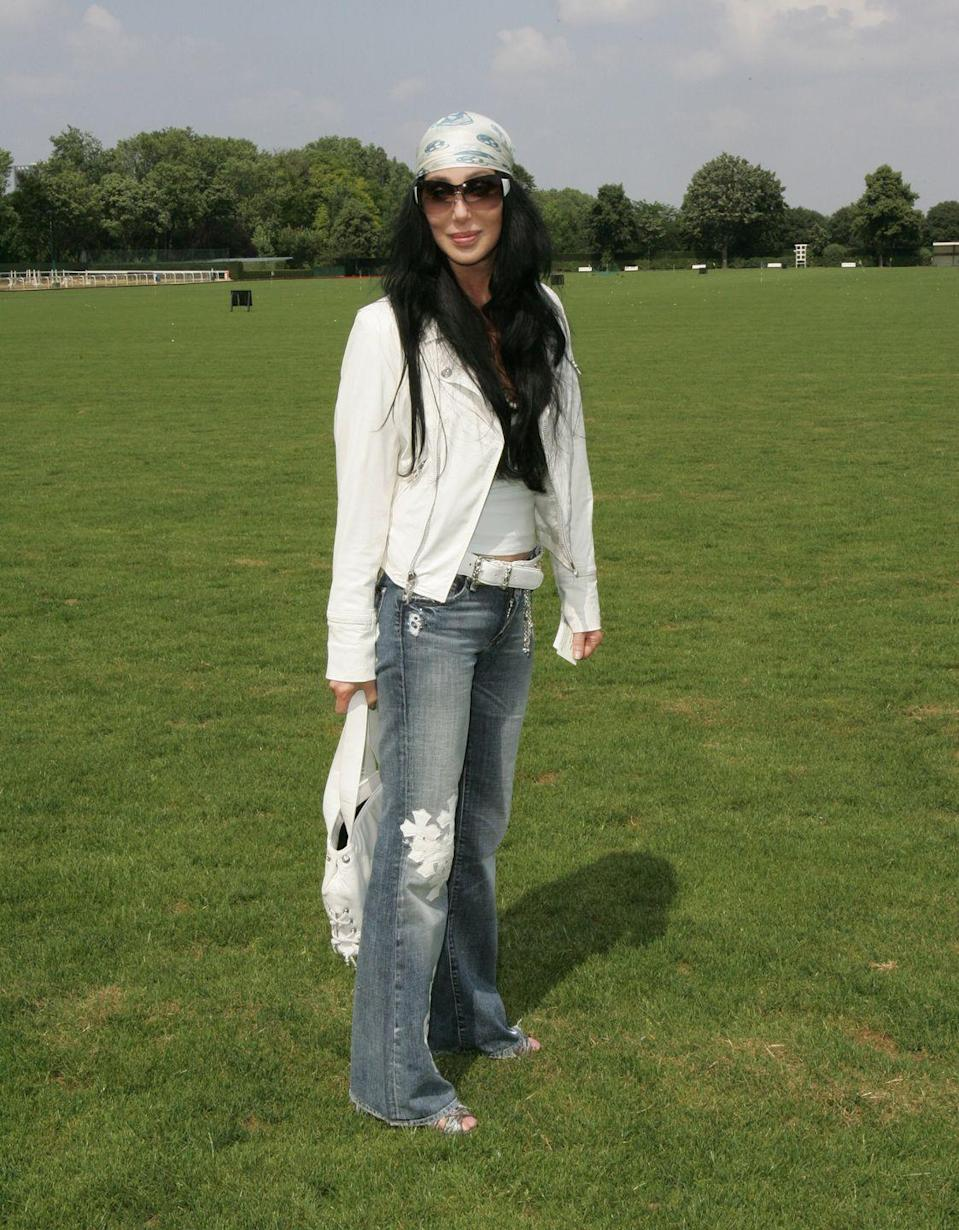 <p>In a bandana, white moto jacket, and cross embroidered jeans for Dior's Polo-themed show during Paris Couture Week. </p>