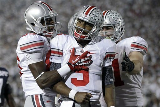Miller and No. 9 Ohio St beat Penn St 35-23
